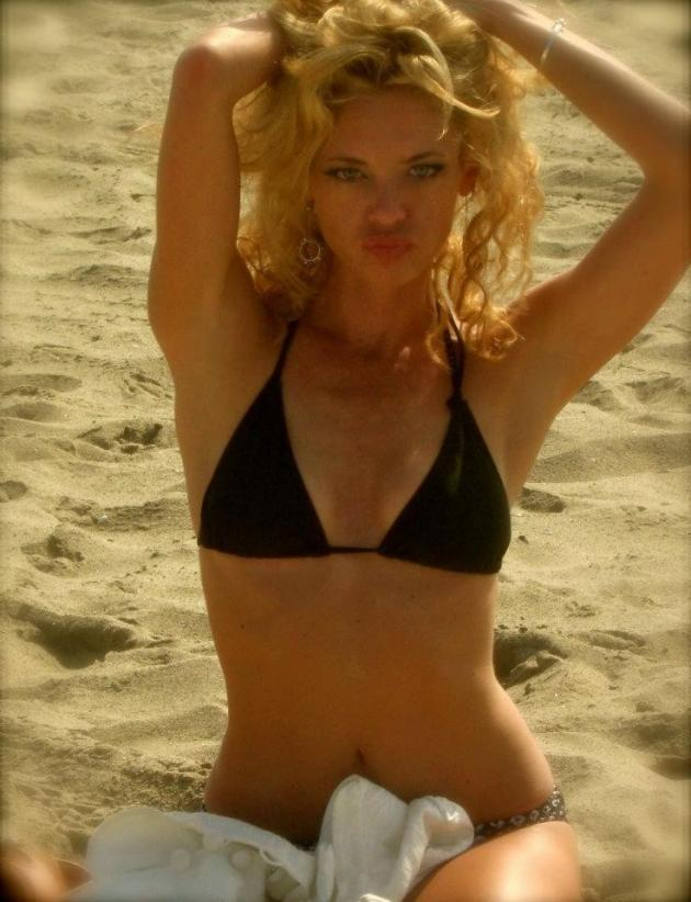 "Lisa Robin Kelly, in a bikini.  That sort of draws attention away from any question of ""does she need make-up to be pretty"""